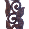 Patinated hammered copper over carved wood